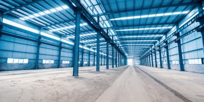 empty steel structure building, factory workshop or warehouse